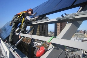 female solar worker with hard hat. Photo Credit: Sun Light & Power