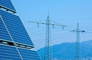 Solar power plant with transmission lines in the background.