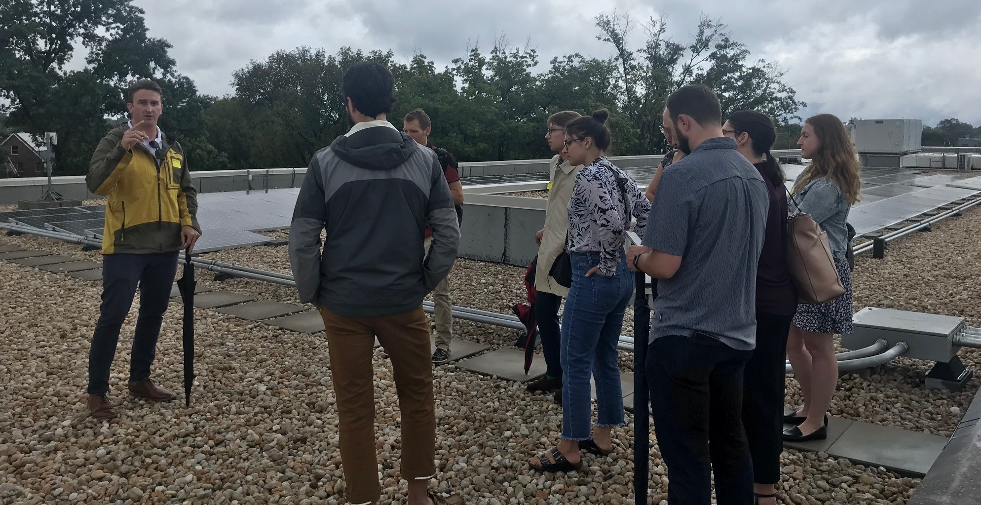 Congressional Staffers learning about rooftop solar array on Capital City Public Charter School