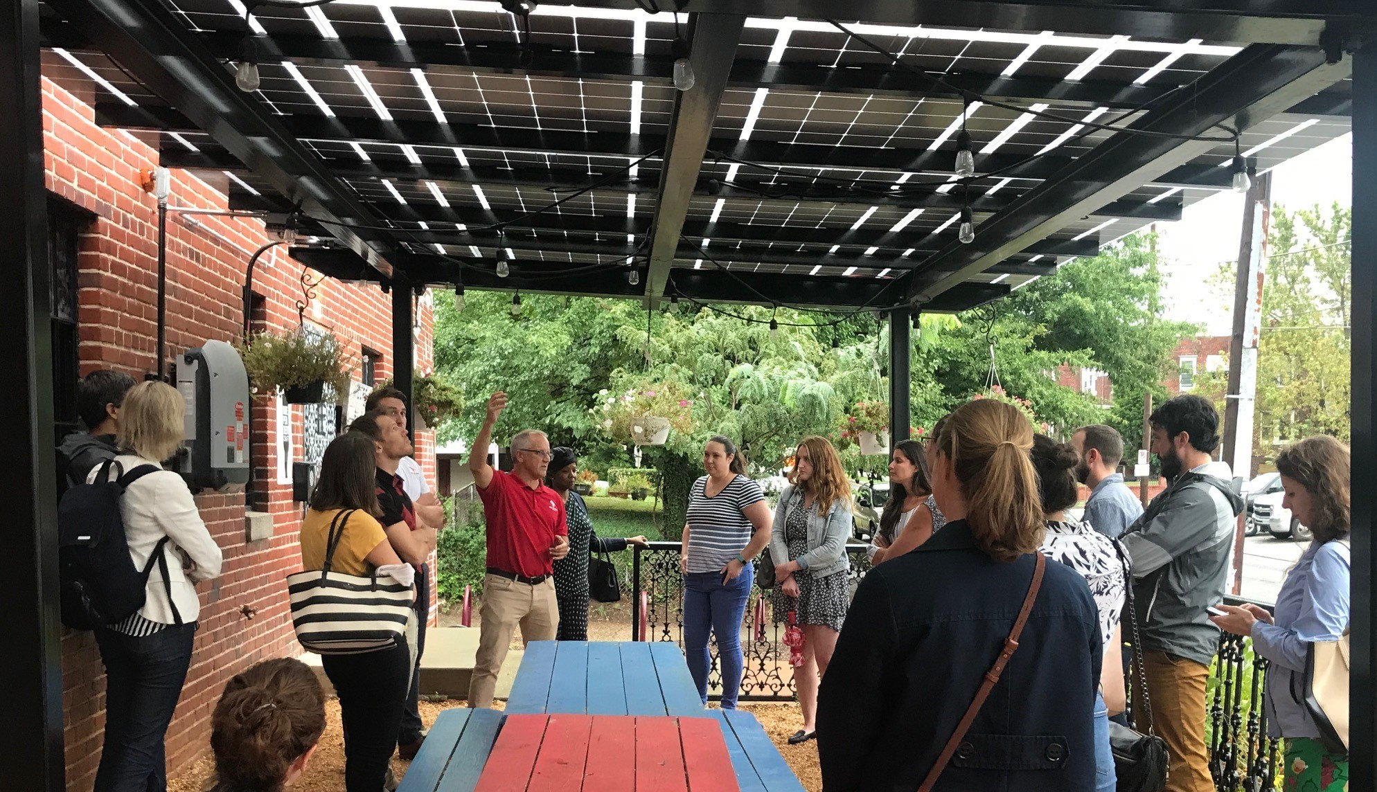 Attendees check out solar array at Right Proper Brewing Company